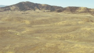 TS01_050 - 1080 stock footage aerial video of flying over hills toward the La Panza Range, California