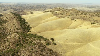 TS01_060 - 1080 stock footage aerial video of flying over round mountains in the La Panza Range, California