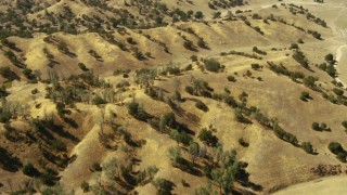 TS01_067 - 1080 stock footage aerial video of tilt from hills to reveal an isolated home in Paso Robles, California