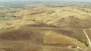 TS01_070 - 1080 aerial stock footage video of flying over hills, pan to farmland in Paso Robles, California