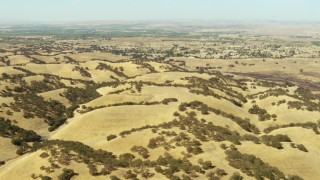TS01_076 - 1080 stock footage aerial video of rolling hills and homes in Paso Robles, California
