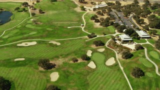 TS01_082 - 1080 stock footage aerial video of flying over golf course in Paso Robles, California