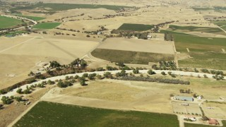 TS01_086 - 1080 stock footage aerial video of flying over farms, dry riverbed, and open fields, Paso Robles, California