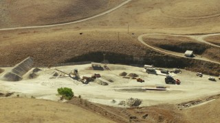 TS01_104 - 1080 stock footage aerial video of an industrial site with equipment in San Ardo, California