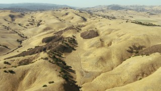 TS01_105 - 1080 stock footage aerial video of flying over hills toward Peach Tree Valley, California
