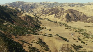 TS01_106 - 1080 stock footage aerial video of flying over Peach Tree Valley with rural homes near mountains, California