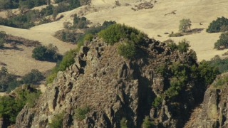 TS01_116 - 1080 stock footage aerial video of the summit of a rugged mountain in Central California