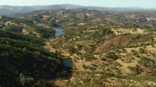 TS01_121 - 1080 aerial stock footage video of flying over hills toward lakes in Morgan Hill, California