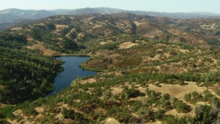 TS01_122 - 1080 stock footage aerial video of flying over a lake and hills in Morgan Hill, California