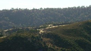 TS01_124 - 1080 stock footage aerial video of passing mountain ridges with trees in Morgan Hill, California