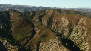 TS01_125 - 1080 stock footage aerial video of approaching tall mountain ridges in Morgan Hill, California