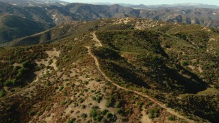 TS01_126 - 1080 stock footage aerial video of flying over green mountains in Morgan Hill, California