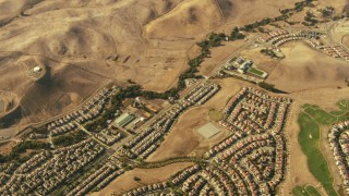 TS01_136 - 1080 stock footage aerial video tilt from homes and hills in Dublin to reveal homes in San Ramon, California