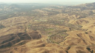 TS01_137 - 1080 stock footage aerial video tilt from homes and hills in San Ramon to reveal part of Mount Diablo, California
