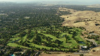 TS01_140 - 1080 stock footage aerial video fly over a golf course and homes in Walnut Creek, California
