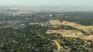 TS01_141 - 1080 stock footage aerial video fly over Concord homes toward refinery and BART depot in California
