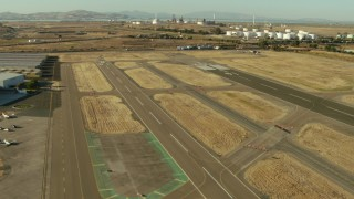TS01_145 - 1080 stock footage aerial video of lifting off from airport near refinery in Pacheco, California