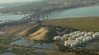 TS01_149 - 1080 stock footage aerial video tilt from refinery to the Benicia-Martinez Bridge in California