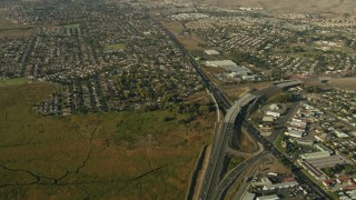 TS01_160 - 1080 stock footage aerial video of freeway interchange and neighborhoods in Vallejo, California
