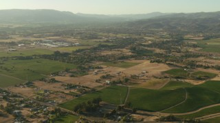 TS01_171 - 1080 stock footage aerial video pan across farms, hills and homes to reveal small airfield in Sonoma, California