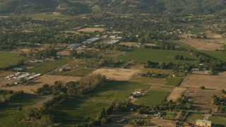 TS01_173 - 1080 stock footage aerial video pan across farm fields and homes in Sonoma, California