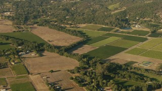 TS01_174 - 1080 stock footage aerial video of farmland and rural homes in Sonoma, California