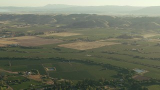 TS01_175 - 1080 stock footage aerial video of Sonoma farm fields and mountains, California