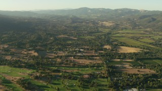 TS01_179 - 1080 stock footage aerial video of golf course, homes and farm fields in Sonoma, California
