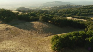 TS01_186 - 1080 stock footage aerial video of fly over trees atop a mountain, reveal a rural home in Sonoma Mountains, California