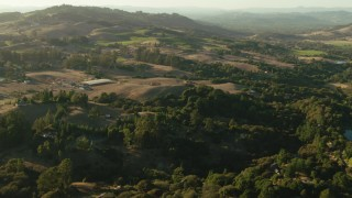 TS01_191 - 1080 stock footage aerial video fly over homes and farms in Bennett Valley, California