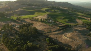 TS01_192 - 1080 stock footage aerial video fly over homes to approach vineyard in Bennett Valley, California