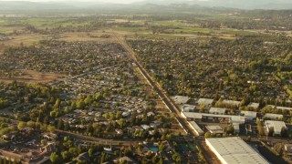 TS01_201 - 1080 stock footage aerial video tilt from train tracks between homes and warehouses, reveal farms, Santa Rosa, California