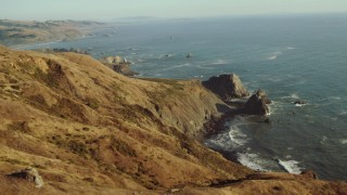 TS01_204 - 1080 stock footage aerial video approach rock formations on the California Coast, overlooking the ocean