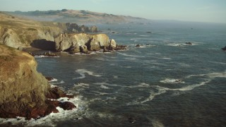 TS01_206 - 1080 stock footage aerial video of rock formations in the ocean on the California Coast