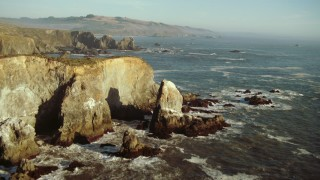 TS01_207 - 1080 stock footage aerial video of flying over rock formations and ocean on the California Coast