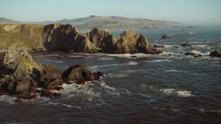 TS01_208 - 1080 stock footage aerial video fly over rock formations to reveal Goat Rock Beach on the California Coast