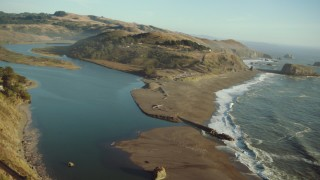 TS01_210 - 1080 stock footage aerial video of flying by Goat Rock Beach on the California Coast