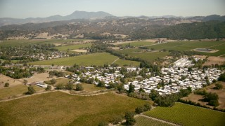 TS01_225 - 1080 stock footage aerial video of approaching fields and mobile home park in Santa Rosa, California