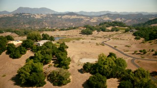TS01_228 - 1080 stock footage aerial video of flying by hilltop homes, small pond in Santa Rosa, California