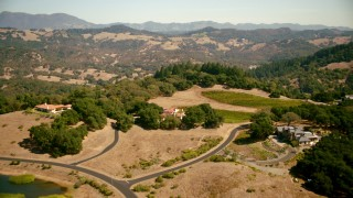 TS01_229 - 1080 stock footage aerial video fly over upscale hilltop homes in Santa Rosa, California