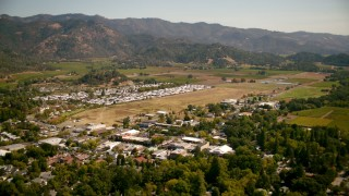 TS01_237 - 1080 aerial stock footage video of flying over town and mobile home, pan across vineyards in Calistoga, California