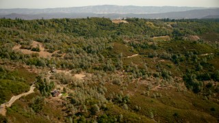 TS01_241 - 1080 stock footage aerial video of pan from home and hills to reveal lakes in Angwin, California
