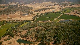 TS01_246 - 1080 stock footage aerial video pan across ponds and vineyards in Pope Valley, California