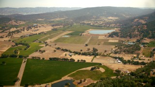 TS01_247 - 1080 stock footage aerial video pan across vineyards to the Pope Valley Airport, California