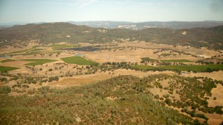 TS01_249 - 1080 stock footage aerial video flyby hills and vineyards in Pope Valley, California
