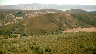 TS01_252 - 1080 stock footage aerial video approach mountain ridges and Lake Berryessa, California