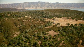 TS01_254 - 1080 stock footage aerial video fly over mountains and farm toward Lake Berryessa, California