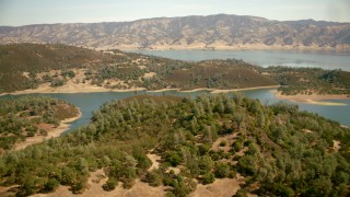 TS01_255 - 1080 stock footage aerial video of approaching the shore of Lake Berryessa, California