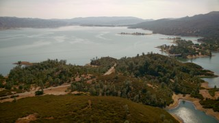 TS01_257 - 1080 stock footage aerial video of Lake Berryessa seen from a road on the shore in California