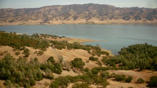 TS01_258 - 1080 stock footage aerial video of flying toward the shore of Lake Berryessa, California